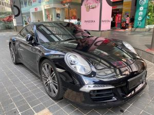 Porsche Carrera S parked in front of Pavillion KL