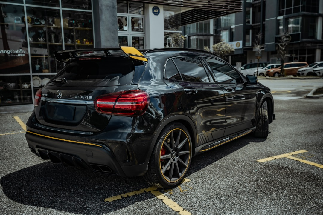 Mercedes GLA45 AMG black with yellow spoiler