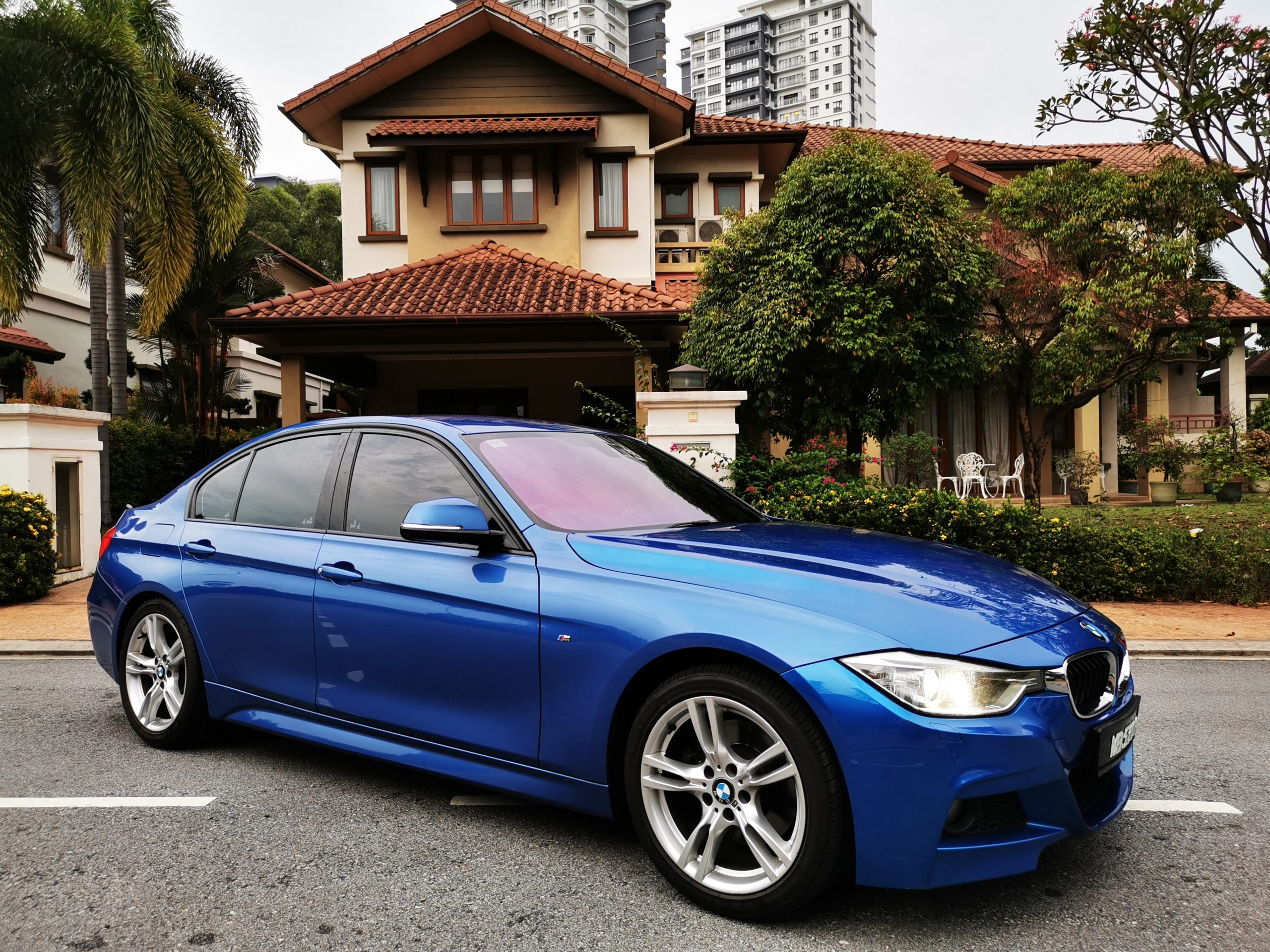BMW M Sport in front of house